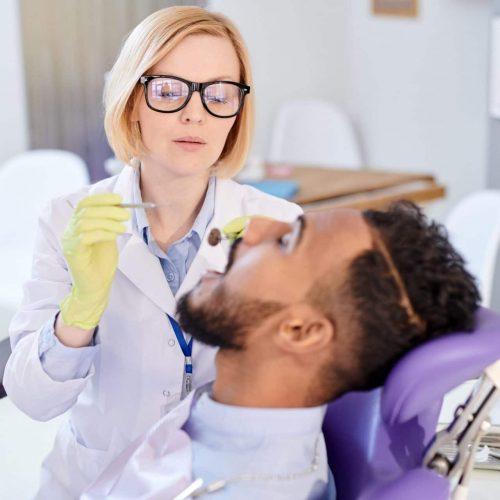 Pretty Dentist Having Appointment
